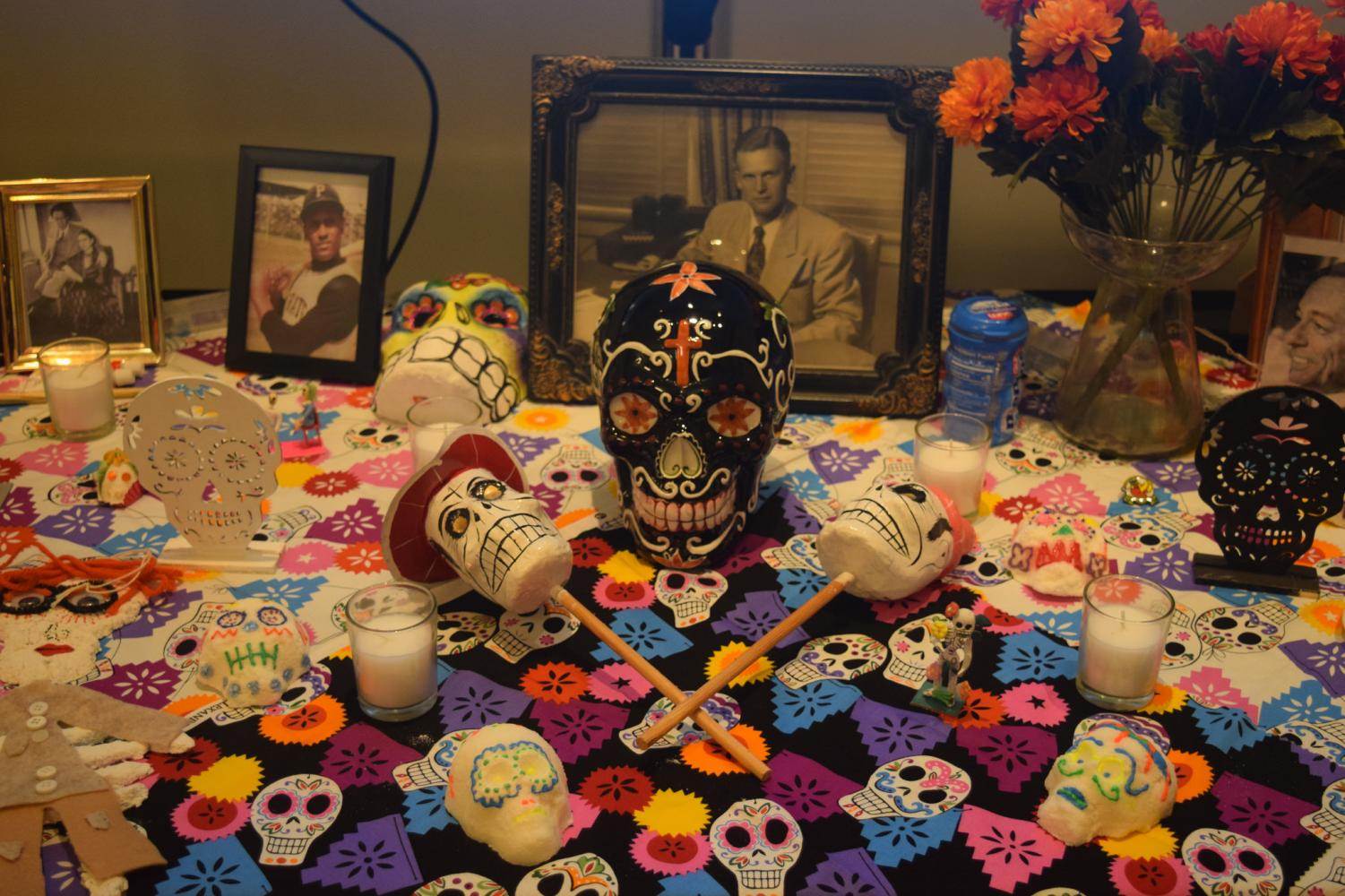 Sugar skulls, photographs and other objects covered the ofrenda outside of the Glassell Gallery.