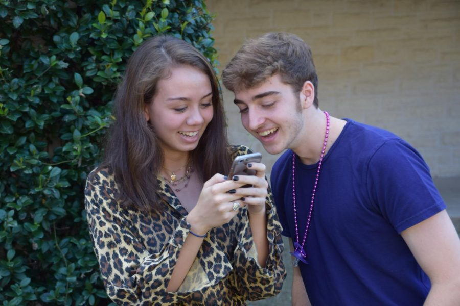 Caitlin Ellithorpe and Robert Hellums check out some of their friends' outfits on social media.