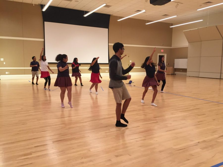SAAG members rehearse one of their four dances before the assembly.