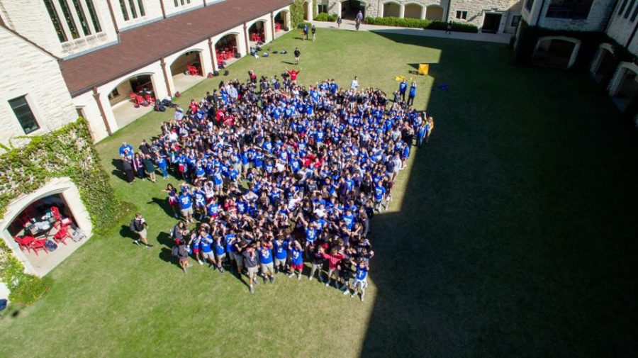 The Upper School gathered on the Great Lawn for a group photo, which will be sent to McKone.