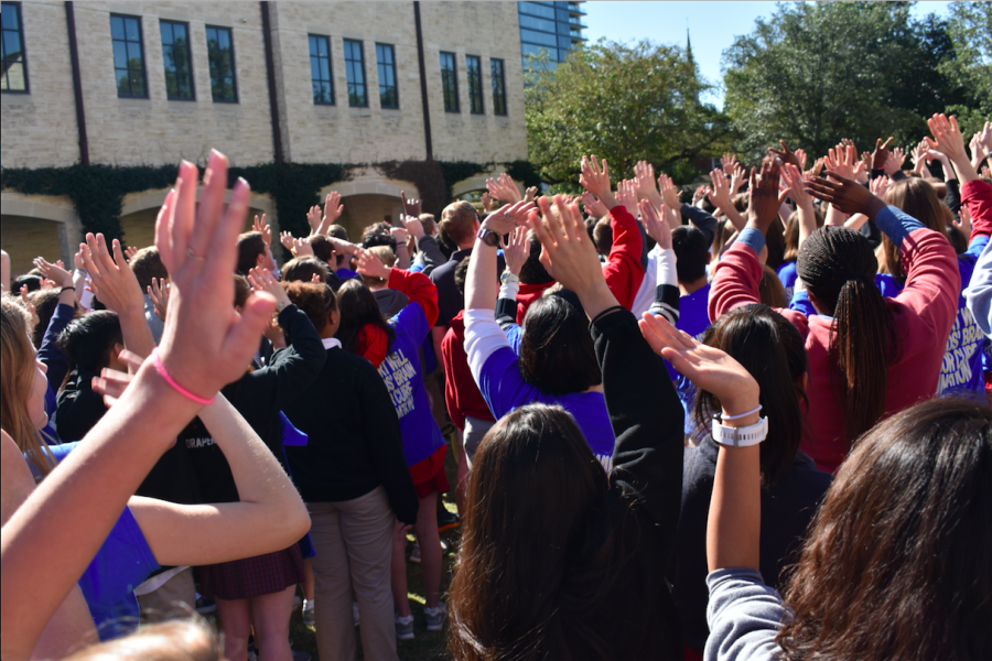 Students raise their hands in support of McKone.