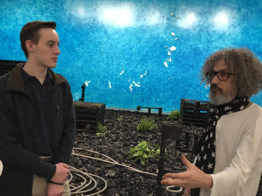 Michel Blazy explains to junior Lawrence Appel the engineering aspects of the installation.
