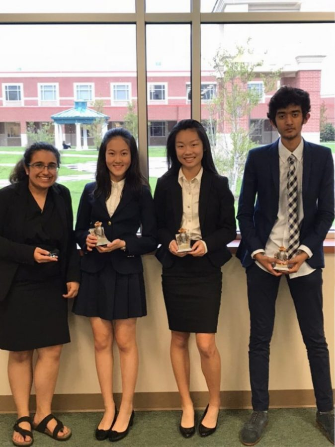 Freshmen Dian Yu and Catherine Lu (pictured center) are two of the 17 freshmen to join this year's debate team.