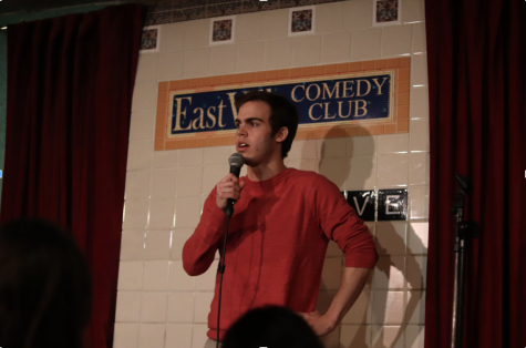Jake Schick performs a comedy routine at EastVille Comedy Club.