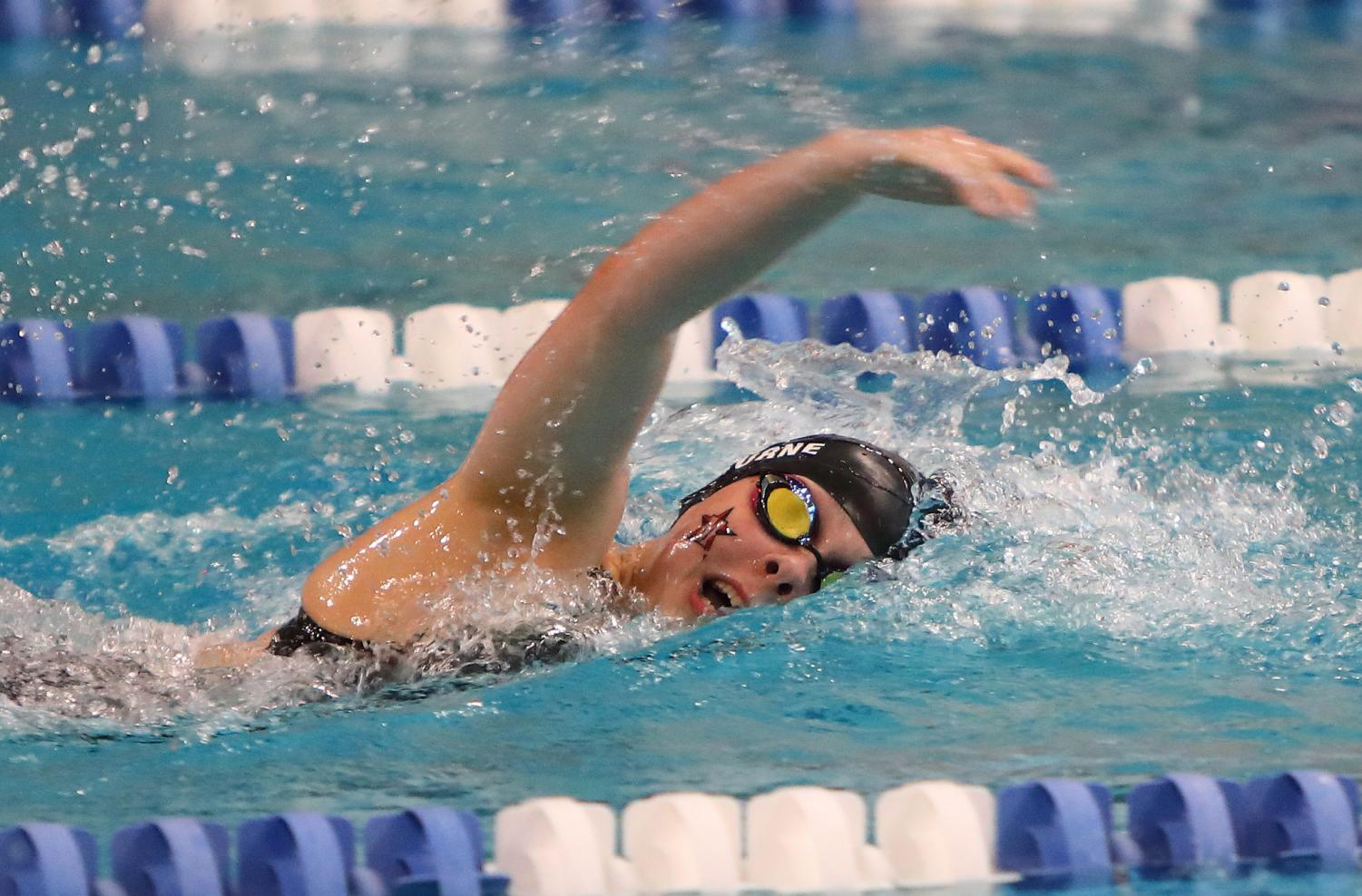 Junior captain Katie Shelburne swims the 500-yard freestyle, breaking the school record for the event.