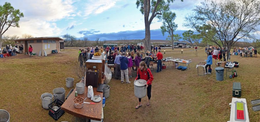 Students prepare dinner at the campground.