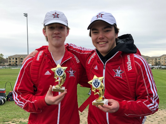 Captain Jackson Edwards and sophomore George Caldwell show off their trophies.