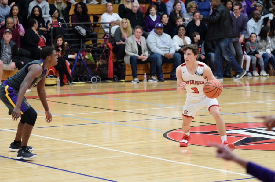 Junior captain Isaac Blue drives to the basket.