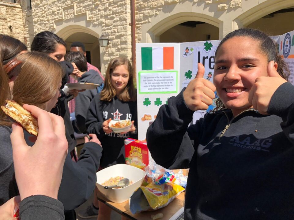 Sophomores+Isabella+O%27Reilly%2C+Carter+Hollingsworth+and+Rachel+Hecht+served+Lucky+Charms%2C+marshmallows+and+potato+chips+at+their+Ireland+booth.