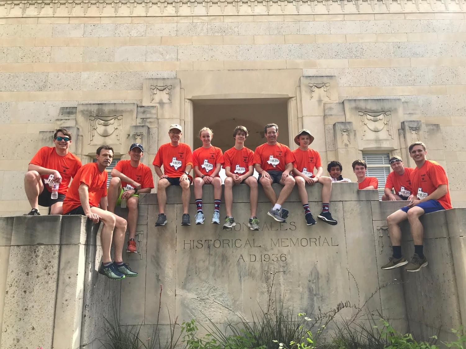 The relay team visits a monument in Gonzales, where the race began.