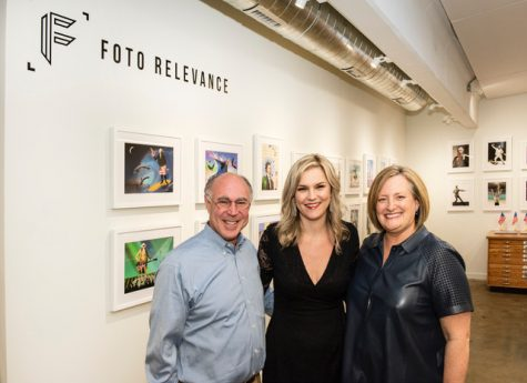 Bryn Larsen (right) and Geoffrey Koslov (left) open an exhibit featuring portraits by Houston-based photographer Julia McLaurin (center).