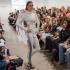 Students walk the runway at a local fashion show