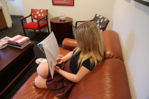 Freshman Lucy Haire reads The Compass Guide to College Admission Testing.