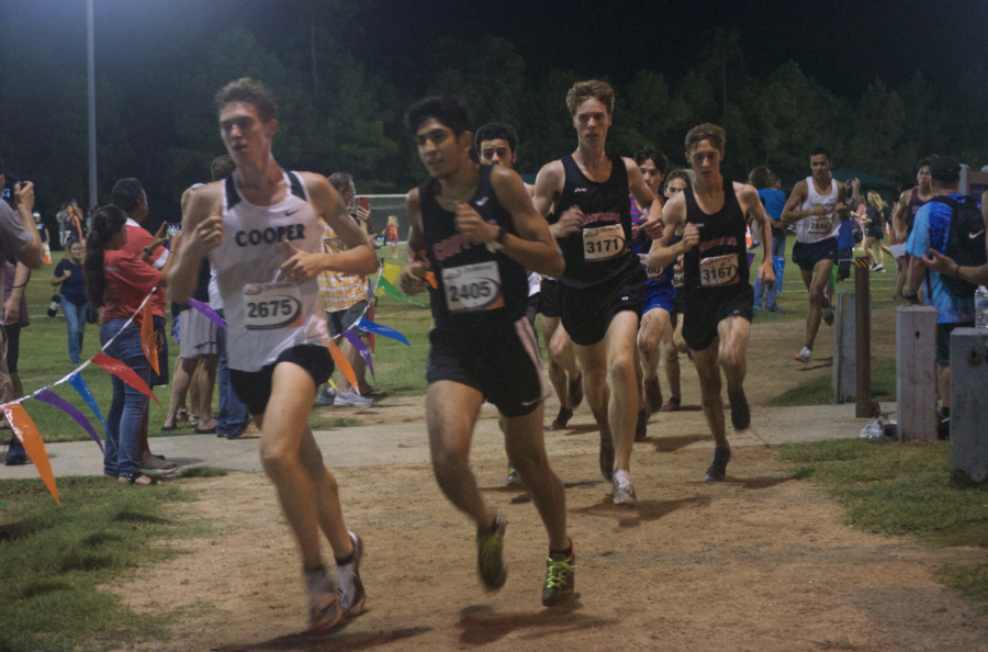 The boys' and girls' cross-country teams competed in their first race of the season at the Friday Night Lights meet in The Woodlands.
