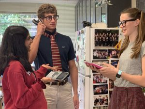 Kinkaid seniors mock the nerdy side of SJS students with stereotypical nerd glasses and TI-84 calculators at the ready.
