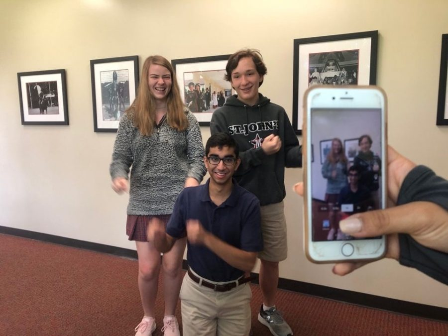 Juniors Julia Smith, Ethan Kinsella and Rahul Rupani dance for a TikTok.