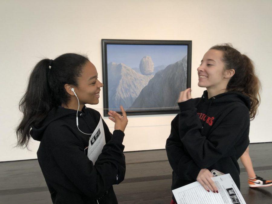Seniors Shelby Wilson and Eleanor Devetski delight in the art around them.