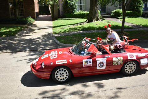 Jacqueline Heal rides through the parade in a car decorated in Maverick and University of Edinburgh stickers.