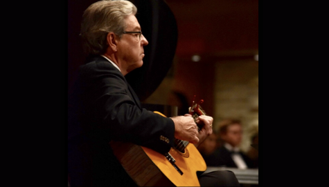 Darrell Parrish plays a guitar accompaniment for choir at Candlelight in December 2018.