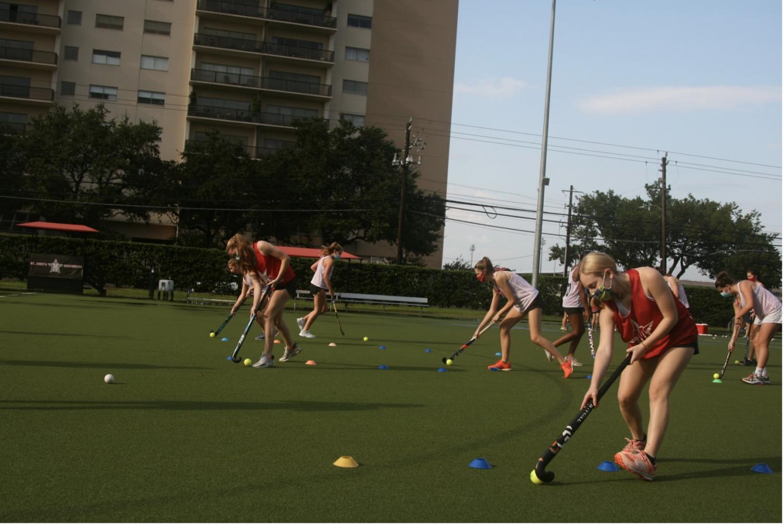 The field hockey team participates in a drill on Finnegan Field.