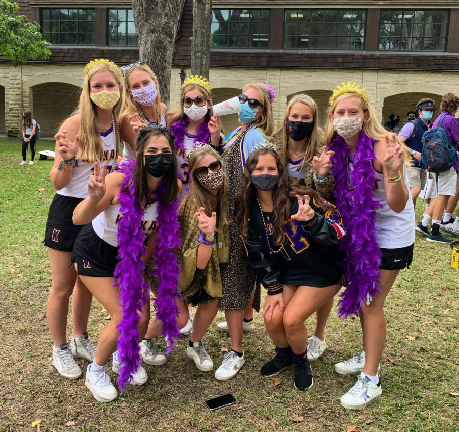 The field hockey seniors traded uniforms with Kinkaid players. They accessorized with patterned masks, leopard print and purple boas.
