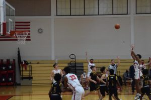 Boys' basketball wins season opener against Fort Bend Christian Academy