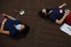Seniors Hannah Chang and Nicole Doyle take their blood pressures as part of an Anatomy and Physiology lab.