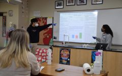Seniors Scott Koh and Isabella O'Reilly give a presentation on their photosynthetic rates lab in AP Biology.