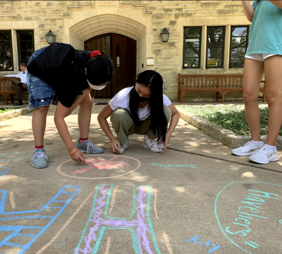 Freshmen Serina Yan and Alexys Shae Tantuco create advisory logos on the plaza.