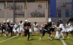 Cole Allen (number 23) runs a route as the Mavs attempt to convert on third down.