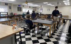 Students enjoy the new physics classroom, which was designed over the summer.
