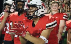 """Senior Matthew Perez cheers on the team as they drive down the field. """"The game was just electric,"""" Perez said. """"I know for all the seniors, getting to beat Episcopal our last year here, is something we'll remember for a long, long time."""""""